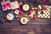 Gifts, cup of coffee and pine branch on a wooden table.  — Stock Photo