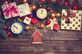 Toy house and christmas gifts, gingerbread, alarm clocks — Stock Photo