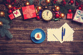 Letter and christmas gifts, coffee with alarm clocks and pine br — Stock Photo