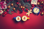 Two cups with christmas tree shape near branch on a table. — Stock Photo