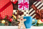 Gingerbread with cup on toys background. — Stock Photo