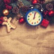Christmas gifts and alarm clock on jute background. — Stock Photo #59050171