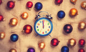 Retro alarm clock with gold, blue and red balls on jute backgrou — Stock Photo