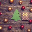 Christmas balls and gift with tree shape toy. — Stock Photo #59319637