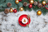 Cappuccino with christmas tree shape and key on artificial snow — Stock Photo