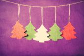 Five christmas tree toys hanging on jute thread. — Stock Photo