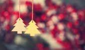 Two christmas tree toys hanging on jute thread. — Stock Photo