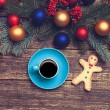 Hot coffee on a table near pine branches with chritmas balls — Stock Photo #59516219