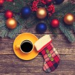 Hot coffee on a table near pine branches with chritmas balls — Stock Photo #59516295