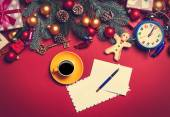 Coffee and letter with christmas gifts on red background.  — Stock Photo