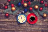 Hot coffee on a table near pine branches with chritmas balls — Stock Photo