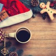 Cup of coffee with pine branch and christmas gifts on wooden bac — Stock Photo #59938361