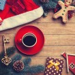 Cup of coffee with pine branch and christmas gifts on wooden bac — Stock Photo #59938329
