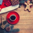 Cup of coffee with pine branch and christmas gifts on wooden bac — Stock Photo #59938333