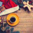 Cup of coffee with pine branch and christmas gifts on wooden bac — Stock Photo #59938335