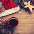 Cup of coffee with pine branch and christmas gifts on wooden bac — Stock Photo #59938339