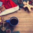 Cup of coffee with pine branch and christmas gifts on wooden bac — Stock Photo #59938355