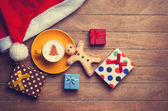 Cappuccino with gingerbread man on wooden table. — Stock Photo