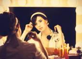 Portrait of a beautiful woman near a mirror — Stock Photo
