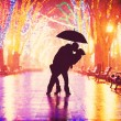 Couple with umbrella kissing at night alley. — Stock Photo #62890189