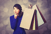 Women in blue dress with shopping bags — Stock Photo