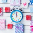 Gift boxes and alarm clock  — Stock Photo #64429219