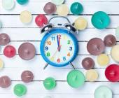 Retro alarm clock and candles  — Stock Photo