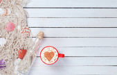 Cup of Cappuccino and net with bottle — Stock Photo