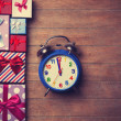 Gift boxes and alarm clock  — Stock Photo #64430047