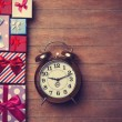 Gift boxes and alarm clock  — Stock Photo #64430067