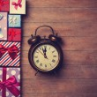 Gift boxes and alarm clock  — Stock Photo #64430081