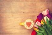 Cappuccino near tulips  — Stock Photo