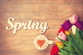 Cappuccino and word Spring near flowers  — Stock Photo
