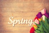 Bouquet of tulips and word Spring — Stock Photo