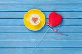 Cup of Cappuccino with heart shape symbol and toy  — Stock Photo