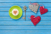 Cup of Cappuccino with heart shape symbol, key and toys — Stock Photo