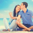 Beautiful couple kissing on the beach. — Stock Photo #65733571