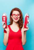 Smiling redhead girl with gumshoes — Stock Photo