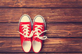 Red gumshoes with white shoelaces  — Stock Photo