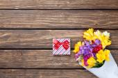Gift box and bouquet of flowers — Stock Photo
