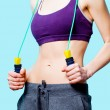 Woman showing her abs — Stock Photo #70247449