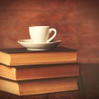 Cup of coffee and books — Stock Photo #70247633