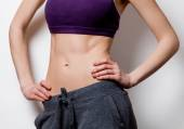 Woman showing her abs after weight loss — Stock Photo