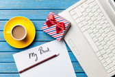 Coffee and paper with laptop — Stock Photo
