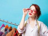 Redhead designer with metric — Stock Photo