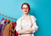Designer with metric and clothes — Stock Photo