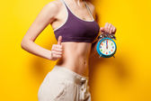 Woman showing her abs — Stock Photo