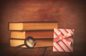 Books with loupe and gift box  — Stockfoto