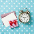 Alarm clock and gift box with envelope  — Stock Photo #71482975