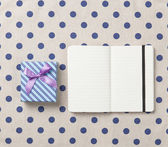 Notebook and gift box  — Stock Photo